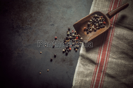 dried assorted peppercorns in a wooden