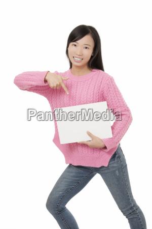 beautiful, chinese, woman, holding, a, blank - 14053357