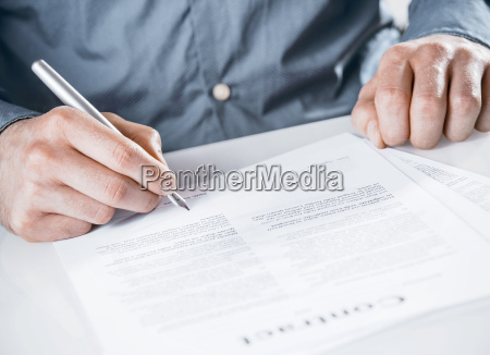businessman, signing, a, legal, document - 14053731