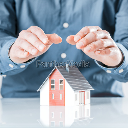 man, protecting, his, house, with, cupped - 14053821