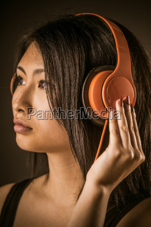 pretty, woman, listening, to, her, music - 14053913