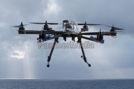 hexacopter drone flying over the ocean