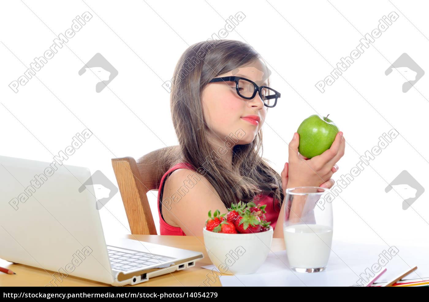 a, little, school, girl, looks, apple - 14054279