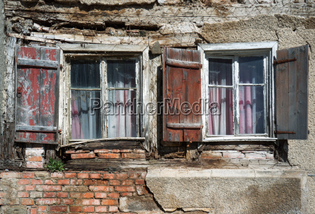 two old weathered windows in the