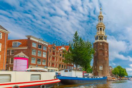 amsterdam canal and tower montelbaanstoren holland