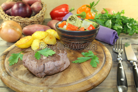 ostrich steaks with crispy oven potatoes