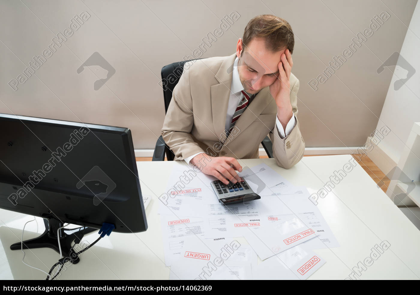 businessman, calculating, unpaid, bills - 14062369