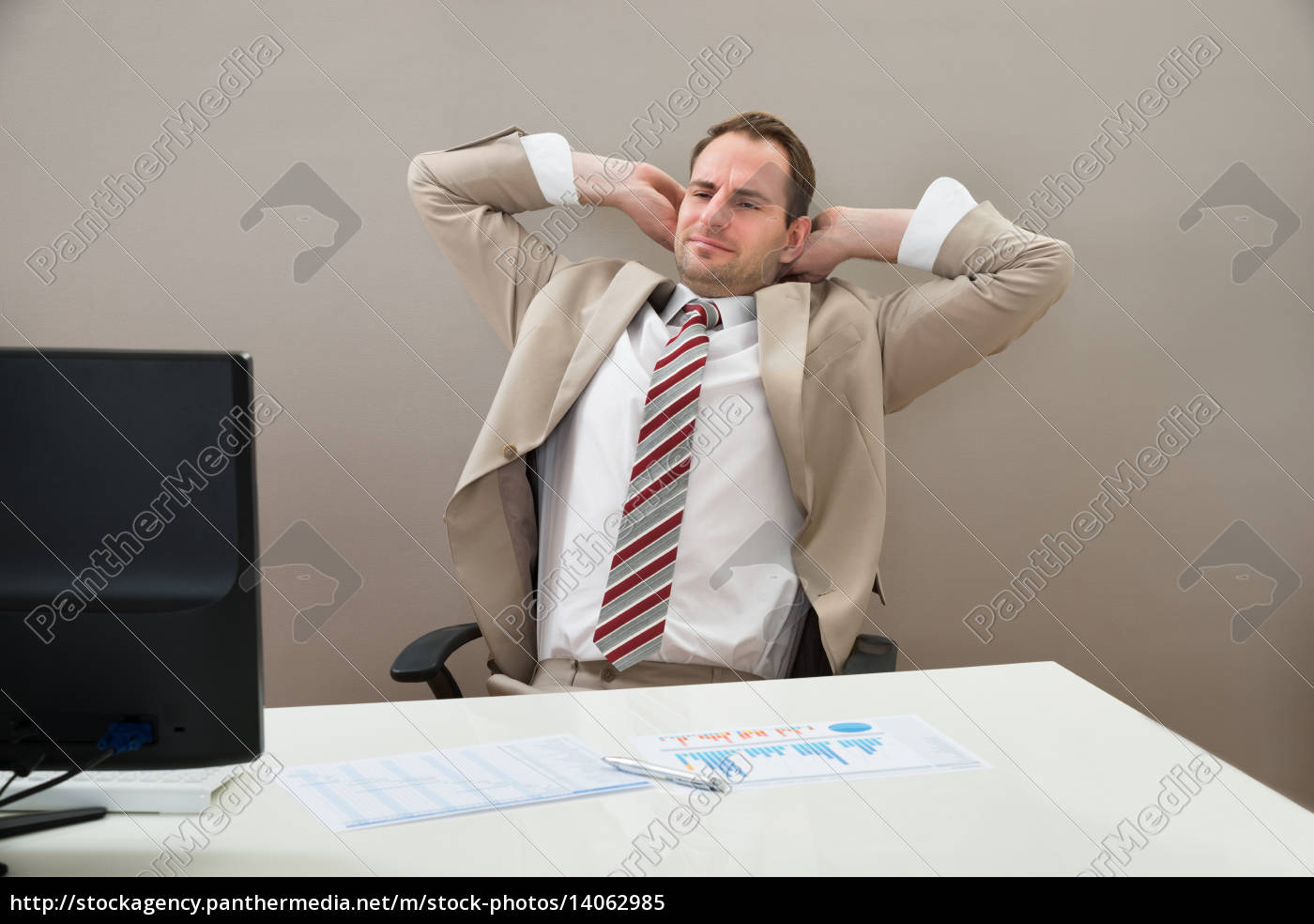 businessman, with, hands, behind, head, in - 14062985