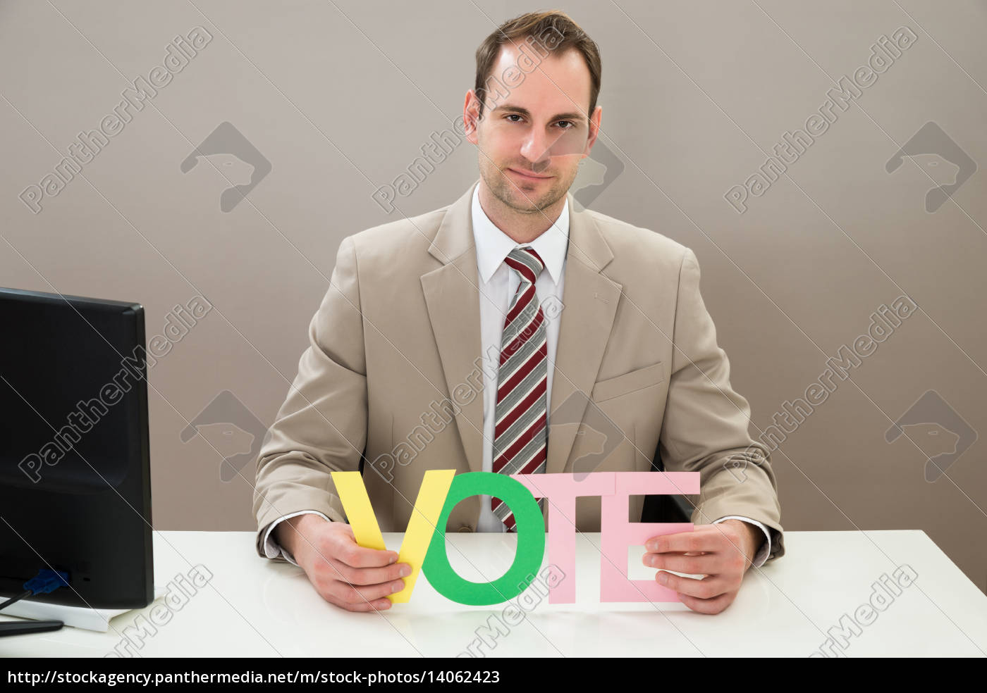 businessman, with, the, multicolored, word, vote - 14062423