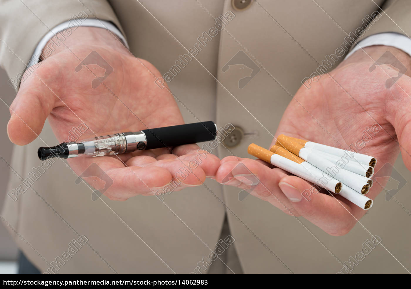 businessperson, hand, with, electronic, cigarette - 14062983