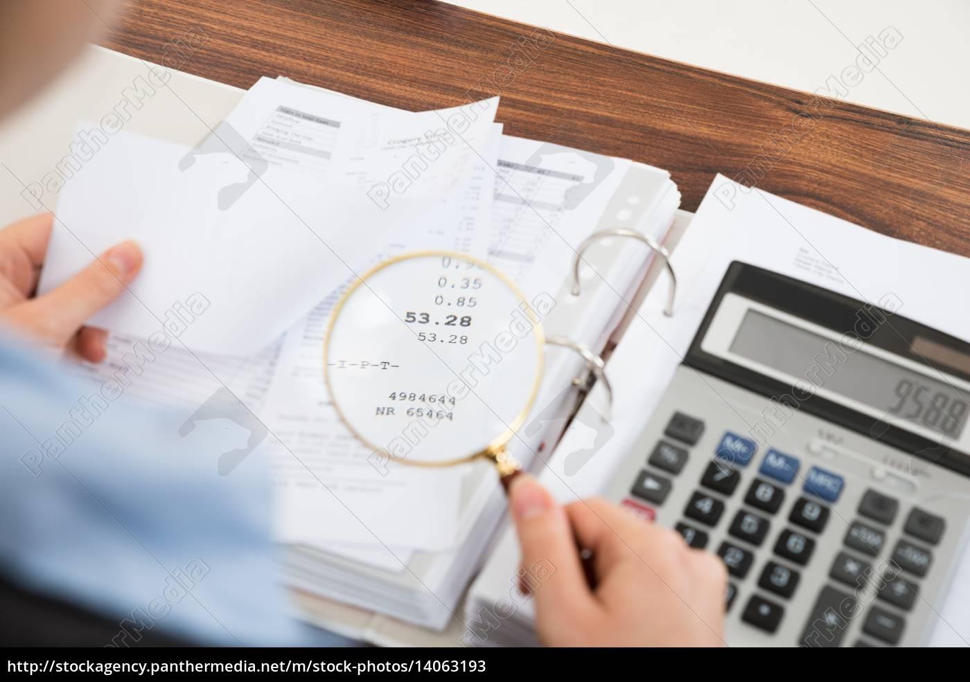 businessperson, examining, receipts - 14063193