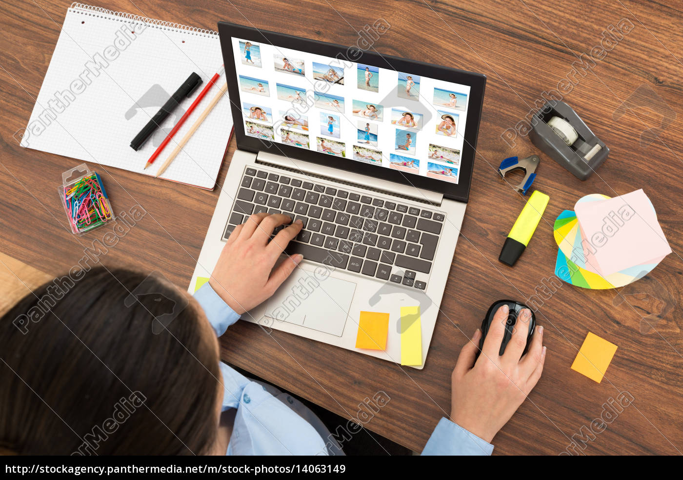 businesswoman, looking, at, picture, on, laptop - 14063149