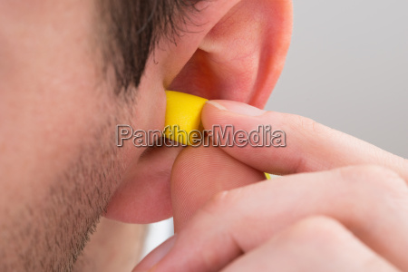 person, ear, with, earplug - 14063565