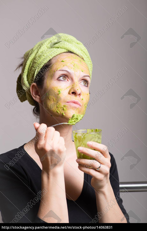 young, woman, with, an, avocado, facial - 14063831