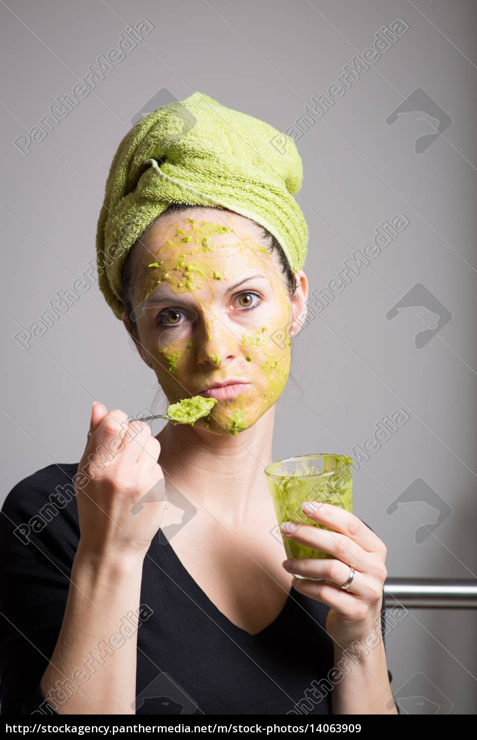 young, woman, with, an, avocado, facial - 14063909