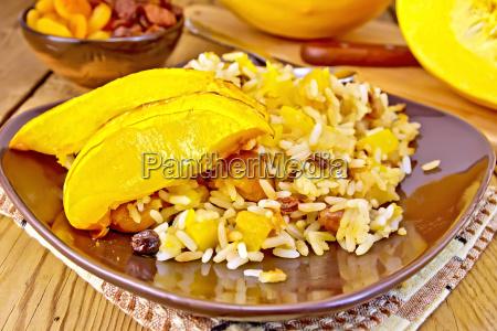 pilaf, fruit, with, pumpkin, in, brown - 14064053