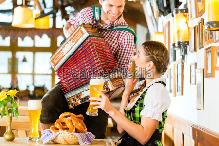 musician plays accordion in the bavarian