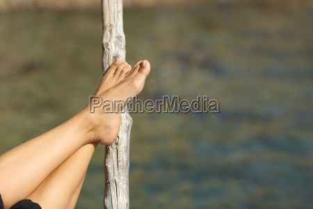 woman feet relaxing on holidays in