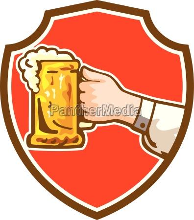 hand holding mug beer crest retro