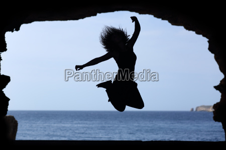silhouette, of, a, woman, jumping, on - 14065493