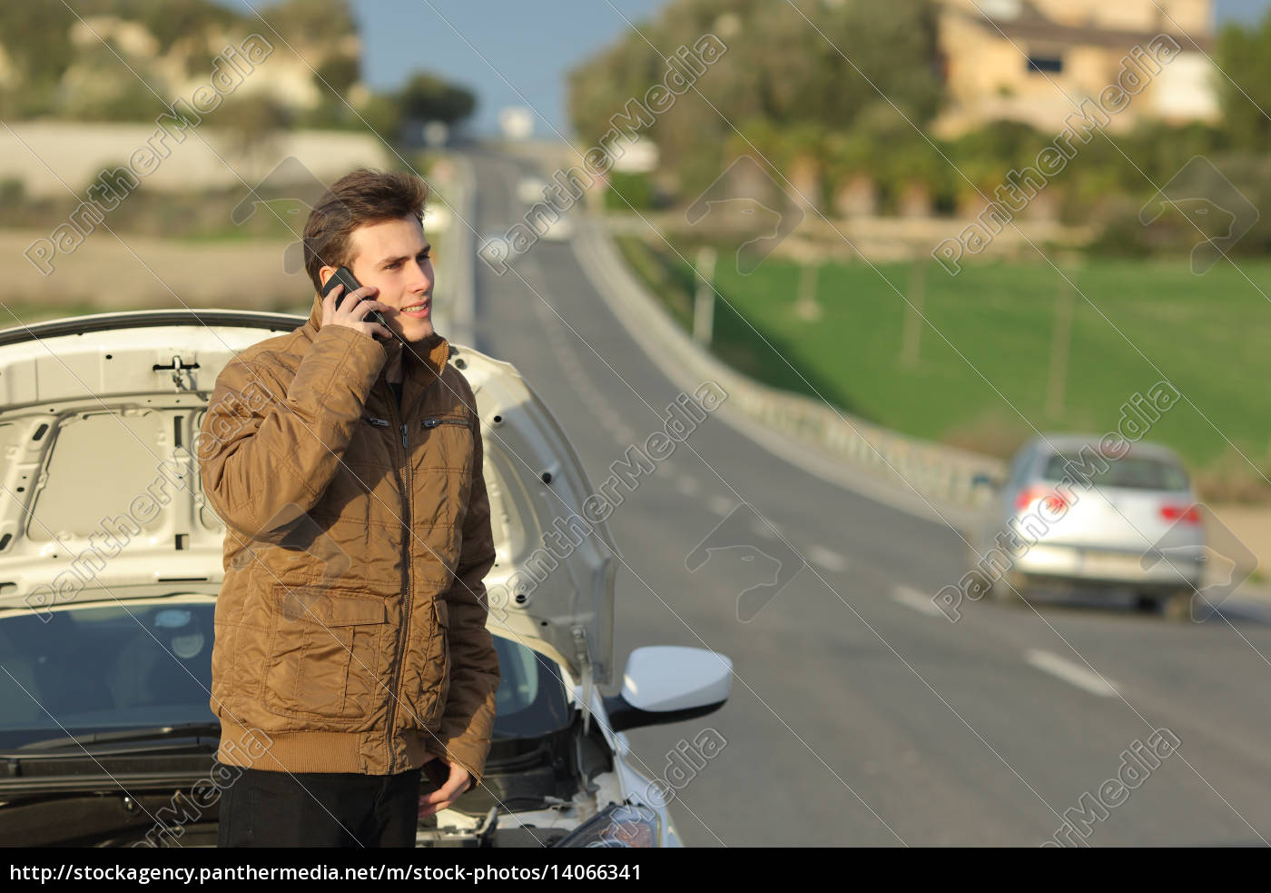 happy, man, calling, roadside, assistance, for - 14066341