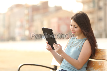 teen, student, girl, reading, a, tablet - 14066451