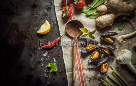 freshly cooked mussels with savory ingredients