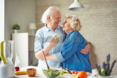 embracing, in, the, kitchen - 14067675