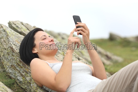 happy, woman, using, a, mobile, phone - 14067001