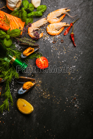 mixed seafood being prepared in a