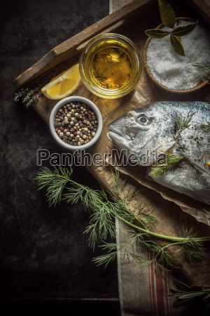 uncooked fresh fish with herbs and