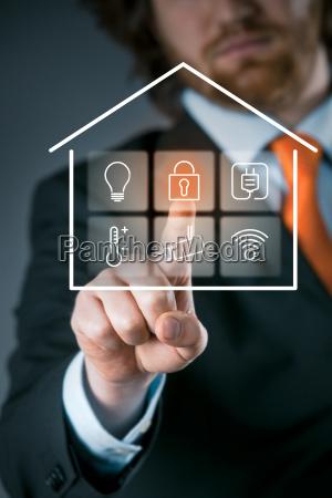 businessman using a smart house control