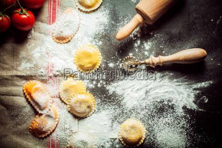 preparing homemade fresh stuffed ravioli pasta