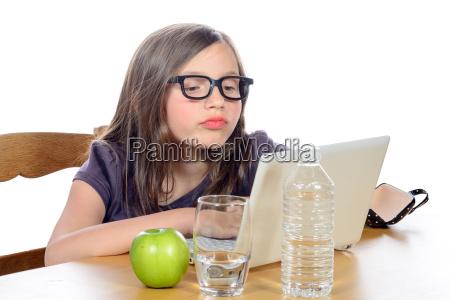 a, little, girl, doing, her, homework - 14068985