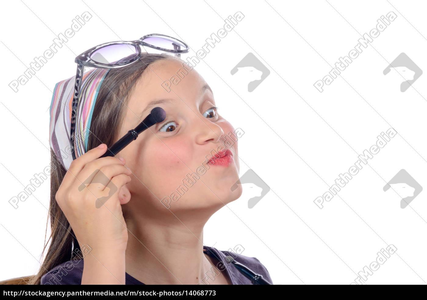 a, little, girl, puts, makeup, of - 14068773