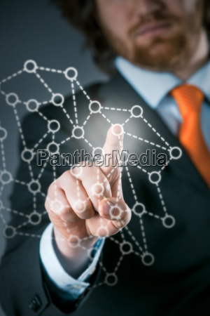 businessman, using, a, network, on, a - 14068065