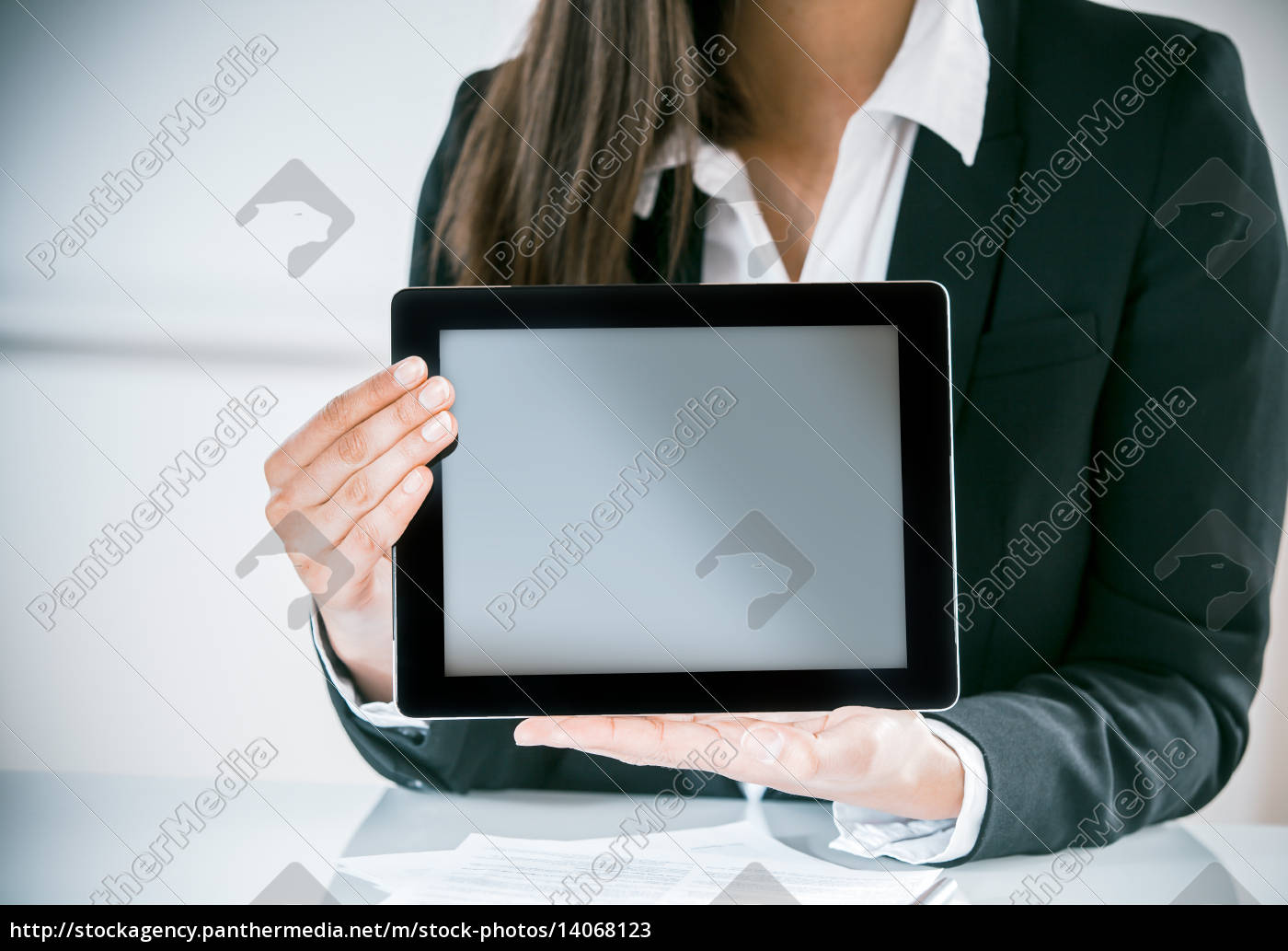 businesswoman, displaying, a, blank, tablet - 14068123