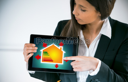 businesswoman, showing, an, energy, efficiency, chart - 14068129