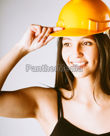 young, woman, holding, her, helmet, over - 14068133