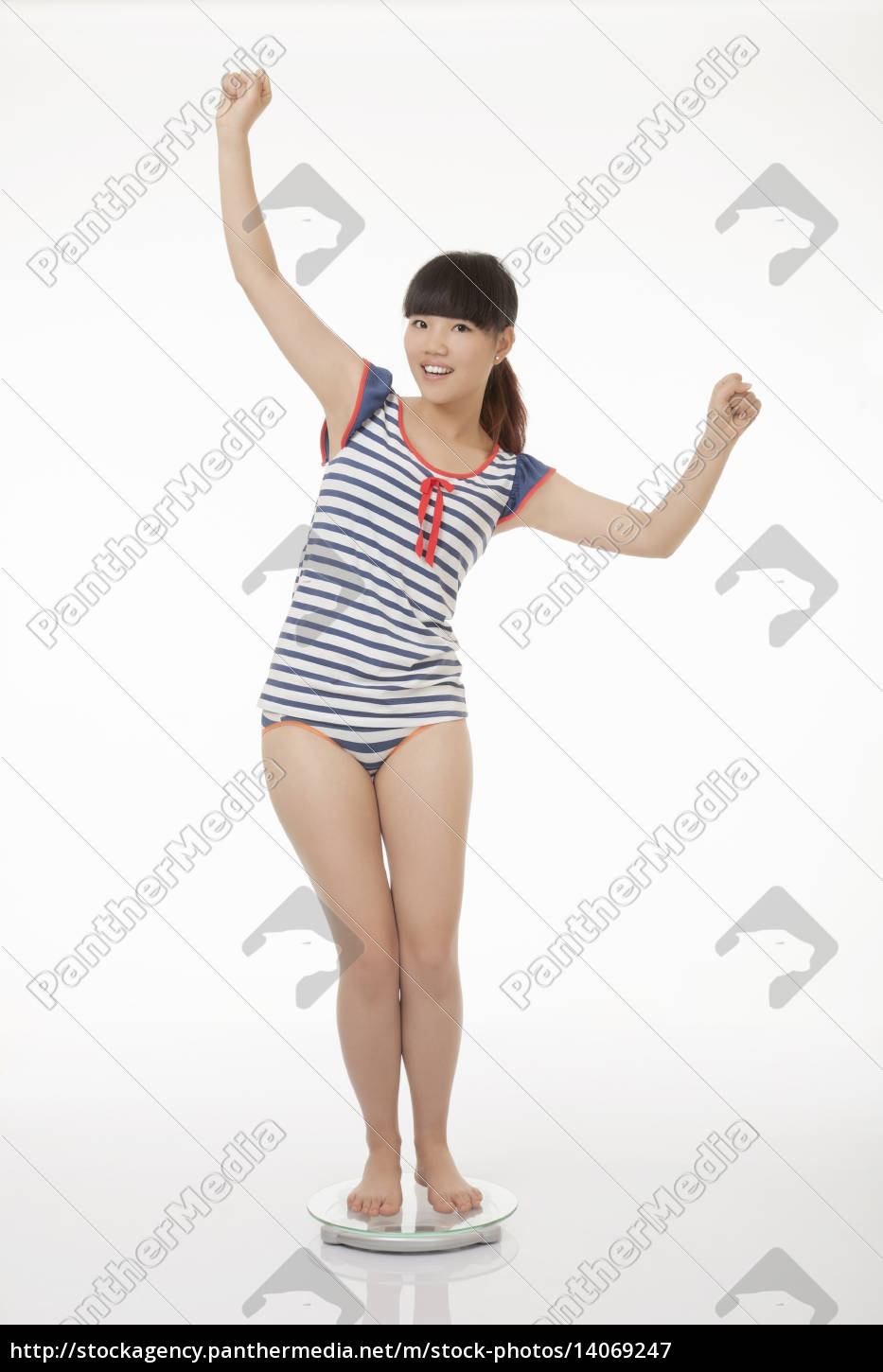 beautiful, asian, woman, weighing, herself, isolated - 14069247