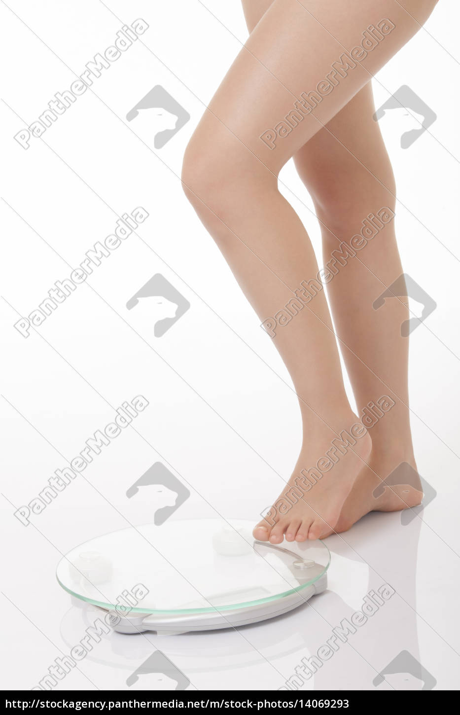 young, woman, stepping, onto, scales, isolated - 14069293
