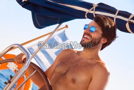 cheerful, captain, behind, wheel - 14070761