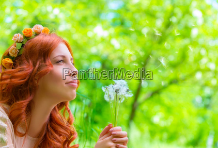 happy, woman, with, dandelions - 14070743