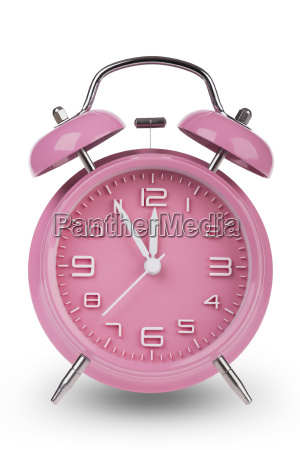 pink alarm clock with hands at