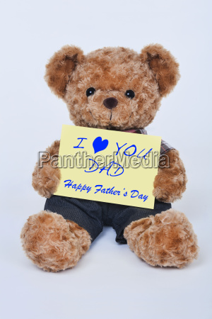 teddy, bear, holding, a, yellow, sign - 14071615
