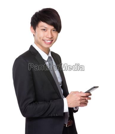 asian, businessman, use, mobile, phone - 14073687
