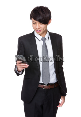 businessman, look, at, cellphone - 14073693