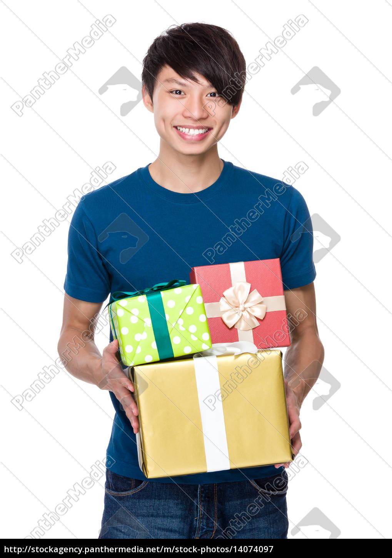 man, hold, lots, of, present, box - 14074097