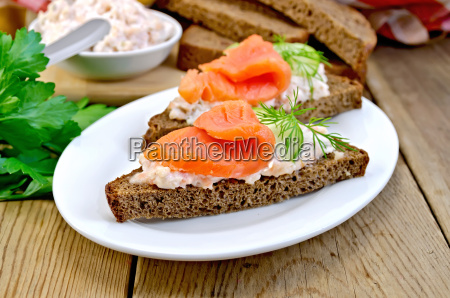sandwich with salmon and cream in