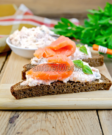 sandwiches on bread with salmon on